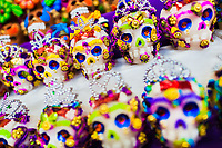 Colorful sugar skull candies are sold on the market during the Day of the Dead festivities in Mexico City, Mexico, 28 October 2016. Skulls, skeletons and the other death symbols are used to adorn graves, altars and offerings during the Day of the Dead (Día de Muertos). A syncretic religious holiday, combining the death veneration rituals of the ancient Aztec culture with the Catholic practice, is celebrated throughout all Mexico. Based on the belief that the souls of the departed may come back to this world on that day, people gather at the gravesites in cemeteries, praying, drinking and playing music, to joyfully remember friends or family members who have died and to support their souls on the spiritual journey.