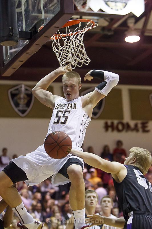 Trent Nelson     The Salt Lake Tribune.Lone Peak's Eric Mika dunks as Lone Peak hosts Riverton High School basketball Wednesday January 9, 2013 in Highland.