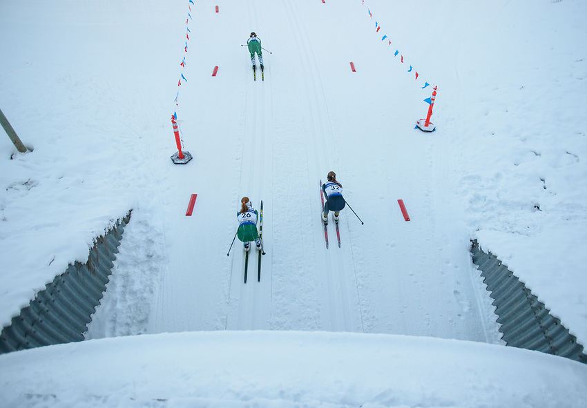 Competitors in the women's 20km Classic exit the tunnel during the 2018 U.S. National Cross Country Ski Championships at Kincaid Park in Anchorage.