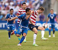 Clarence Goodson (21) of the United States holds off Rodolfo Zelaya (11) of El Salvador during the quarterfinals of the CONCACAF Gold Cup at M&T Bank Stadium in Baltimore, MD.  The United States defeated El Salvador, 5-1.