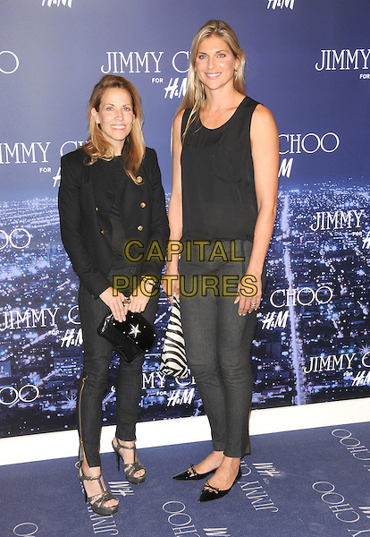 SHERYL CROW & GABRIELLE REECE .at The Jimmy Choo for H&M Launch Party in support of The Motion Picture & Television Fund held at  a private residence in West Hollywood, California, .USA, November 2nd 2009..full length  black military buttons jacket jeans grey gray open toe platform sandals clutch bag tall short pointy shoes flats flat sleeveless top zebra animal print striped .CAP/RKE/DVS.©DVS/RockinExposures/Capital Pictures.