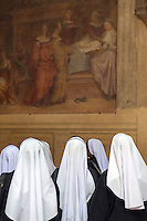 Nuns pause in admiration in the basilica of San Marco, Florence.