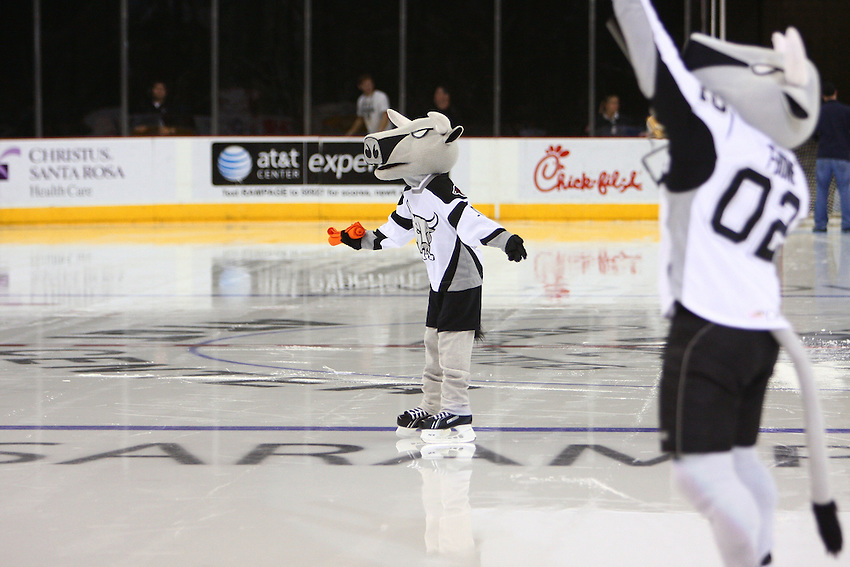 San Antonio Rampage mascots T-Bone, right, and Mini T-Bone launch tee shirts to the crowd during the second period of an AHL hockey game, Saturday, April 11, 2009, in San Antonio, Texas. (Darren Abate/pressphotointl.com)
