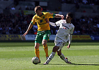 ATTENTION SPORTS PICTURE DESK<br /> Pictured: Sammy Clingan of Norwich (L) challenged by Jordi Gomez of Swansea (R)<br /> Re: Coca Cola Championship, Swansea City FC v Norwich City FC at the Liberty Stadium Swansea, south Wales. Saturday 11 April 2009.<br /> Picture by D Legakis Photography / Athena Picture Agency, Swansea 07815441513