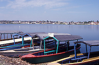 Tourist launches docked in Flores, an island town in Lake Peten Itza, El Peten, Guatemala