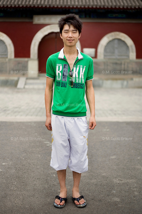 Zhouwendou, a utility worker, age 21, poses for a portrait in Beijing. Response to 'What does China mean to you?': 'Harmonious. Friendly. United. Warm-hearted.'  Response to 'What is your role in China's future?': 'The future will be even better.'