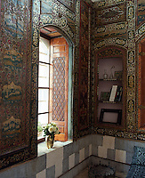The walls of the traditional drawing room are lined with embossed leather