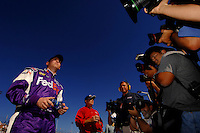 Nov 12, 2005; Phoenix, Ariz, USA; Nascar Nextel Cup driver Denny Hamlin watches the final car attempt to knock him from the pole position for the Checker Auto Parts 500 at Phoenix International Raceway. Mandatory Credit: Photo By Mark J. Rebilas