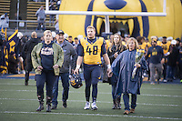 BERKELEY, CA - November 26, 2016: Bradley Northnagel (48) walks onto the field with his family during Senior Day. Cal played UCLA at California Memorial Stadium.