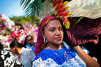"""Salvadoran girls carry an altar with a statue of Virgin Mary during the procession of the Flower & Palm Festival in Panchimalco, El Salvador, 8 May 2011. On the first Sunday of May, the small town of Panchimalco, lying close to San Salvador, celebrates its two patron saints with a spectacular festivity, known as """"Fiesta de las Flores y Palmas"""". The origin of this event comes from pre-Columbian Maya culture and used to commemorate the start of the rainy season. Women strip the palm branches and skewer flower blooms on them to create large colorful decoration. In the afternoon procession, lead by a male dance group performing a religious dance-drama inspired by the Spanish Reconquest, large altars adorned with flowers are slowly carried by women, dressed in typical costumes, through the steep streets of the town."""