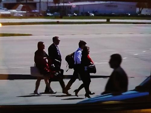 Equipo de Prensa de la Casa Blanca que viajó a bordo del avión presidencial.