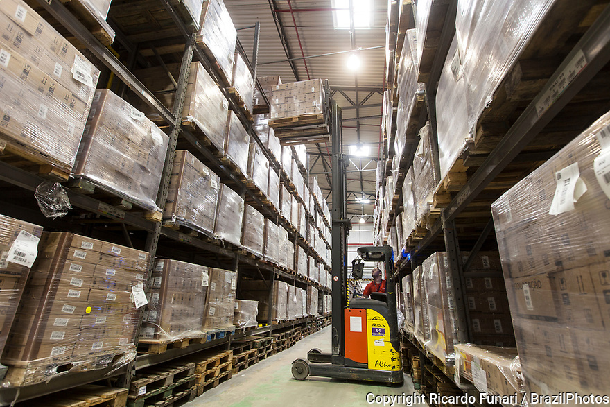 Multinational cosmetics company headquartered in France L`Oreal plant in Rio de Janeiro, Brazil - Forklift Operator putting pallets of final product in stock.