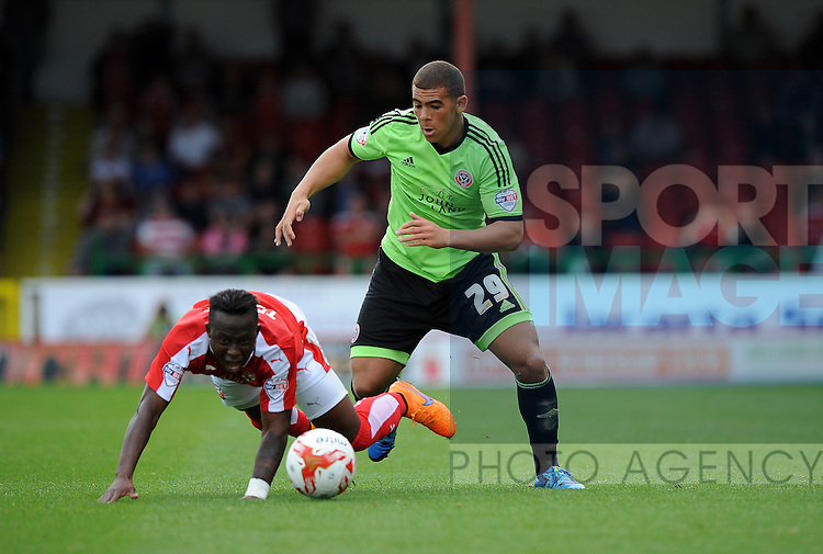 Drissa Traore of Swindon Town is challenged by Drissa Traore of Swindon Town<br /> - English League One - Swindon Town vs Sheffield Utd - County Ground Stadium - Swindon - England - 29th August 2015