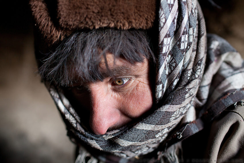 A Wakhi man's green eyes. In Kö Metek..Trekking up to the Little Pamir with yak caravan over the frozen Wakhan river.