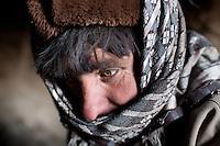 A Wakhi man's green eyes. In Kö Metek..Trekking up to the Little Pamir with yak caravan over the frozen Wakhan river.