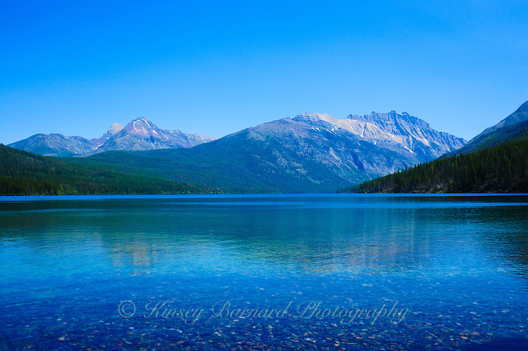 Kintla Lake at Glacier National Park in Montana. Beautiful green and blue water with Rockies in the background