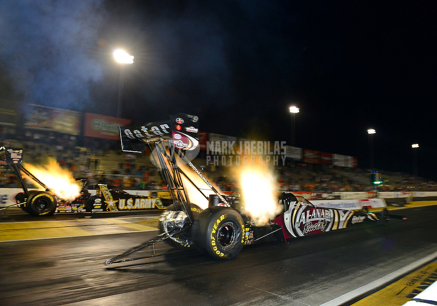 Sept. 28, 2012; Madison, IL, USA: NHRA top fuel dragster driver Shawn Langdon (near lane) races alongside Tony Schumacher during qualifying for the Midwest Nationals at Gateway Motorsports Park. Mandatory Credit: Mark J. Rebilas-