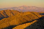 Sunrise light on hills and the distant Mount San Gorgonia peak from Keys View, Joshua Tree National Park, California