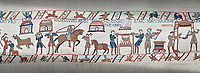 Bayeux Tapestry scene 41 - 42:  Cooks are supervised by Wadar, one of Williams servants.