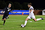 GREENSBORO, NC - DECEMBER 02: Nick West #11 of Messiah College prepares to kick a pass past Jason Gonzalez #15 of North Park University during the Division III Men's Soccer Championship held at UNC Greensboro Soccer Stadium on December 2, 2017 in Greensboro, North Carolina. Messiah College defeated North Park University 2-1 to win the national title. (Photo by Grant Halverson/NCAA Photos via Getty Images)
