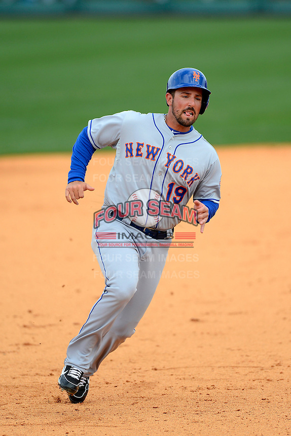 New York Mets outfielder Zach Lutz #19 during a Spring Training game against the Detroit Tigers at Joker Marchant Stadium on March 11, 2013 in Lakeland, Florida.  New York defeated Detroit 11-0.  (Mike Janes/Four Seam Images)