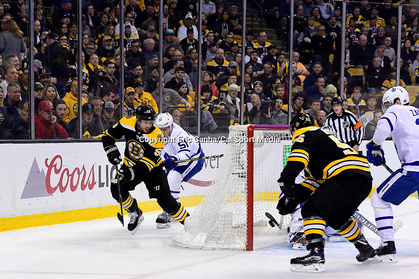 April 21, 2018: Boston Bruins center Noel Acciari (55) scores a goal against Toronto Maple Leafs goaltender Frederik Andersen (31) during game five of the first round of the National Hockey League's Eastern Conference Stanley Cup playoffs between the Toronto Maple Leafs and the Boston Bruins held at TD Garden, in Boston, Mass. Toronto defeats Boston 4-3, Boston leads Toronto 3 games to 2 in the best of 7 series.