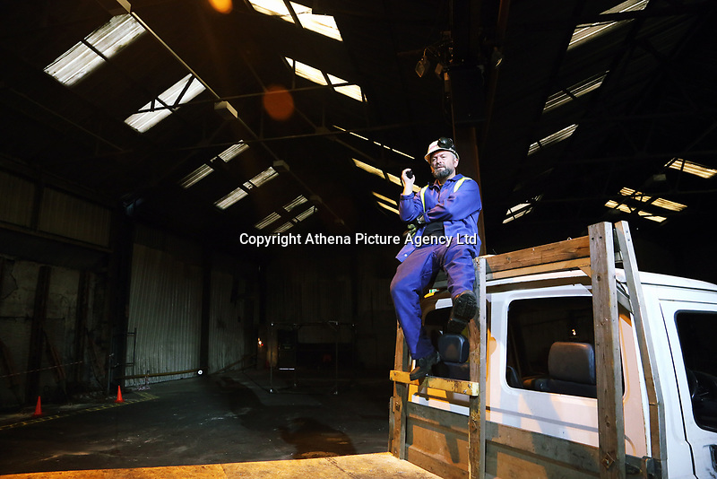 """Pictured: Actor Jason May who plays Rob<br /> Re: Press rehearsal of """"We'Re Still Here"""", a play created by Rachel Trezise, Common Wealth and the National Theatre Wales about steelworkers, which will be performed in Byass Works, a disused industrial unit, in Port Talbot, south Wales, UK."""