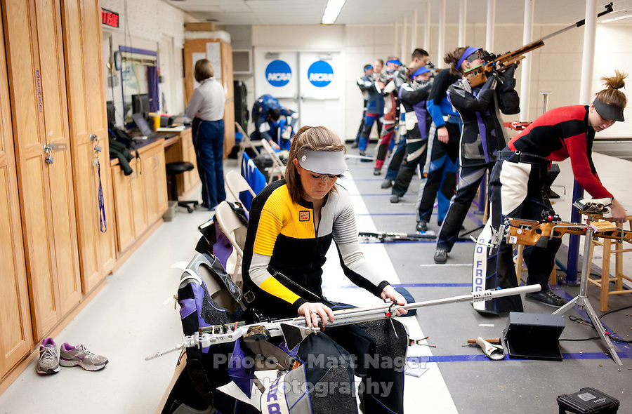 Caitlin Morrissey (cq), with the Texas Christian University Women's Rifle Team, puts away her rifle after finishing her standing portion during a qualifying shooting match at the TCU campus in Ft. Worth, Texas, Saturday, February 12, 2011. The TCU team is undefeated this season and won the national championship last year to become the first all women's team to win the championship...CREDIT: Matt Nager for The Wall Street Journal