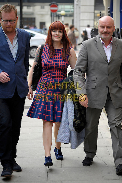 Ana Matronic (Ana Lynch) of Scissor Sisters<br /> Spotted in London, England.<br /> September 25th, 2013<br /> full length pink blue check dress sleeveless tattoo shoes carrying coats jackets<br /> CAP/IA<br /> &copy;Ian Allis/Capital Pictures