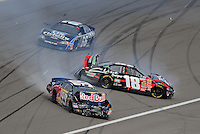Feb. 28, 2009; Las Vegas, NV, USA; NASCAR Nationwide Series driver Kyle Busch (18) and Scott Speed (99) crash during the Sam's Town 300 at Las Vegas Motor Speedway. Mandatory Credit: Mark J. Rebilas-
