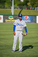 Yensys Capellan (10) of the Ogden Raptors warms up in the outfield before the game against the Orem Owlz in Pioneer League action at Home of the Owlz on June 20, 2015 in Provo, Utah. The Raptors defeated the Owlz 9-6.   (Stephen Smith/Four Seam Images)
