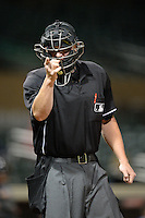 Home plate umpire Tom Woodring during an Arizona Fall League game between the Salt River Rafters and Mesa Solar Sox on October 10, 2013 at Salt River Fields at Talking Stick in Scottsdale, Arizona.  Mesa defeated Salt River 8-1.  (Mike Janes/Four Seam Images)