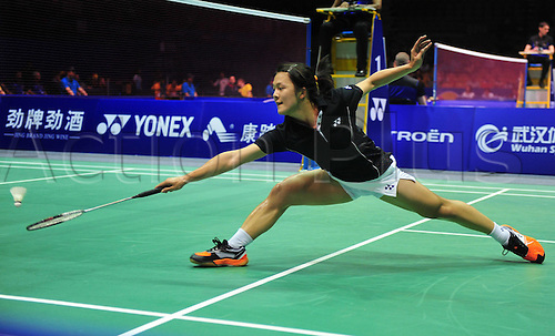 21.05.2012. Wuhan, China.  Rena Wang of The United States Returns A Shot to Denmark s Tine Baun during The About Cup World Badminton team Championships in Wuhan Central China s Hubei Province ON May 21 2012 Denmark Beat The U.S. 4 1