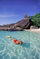 A snorkeler explores sunlit shallows at Ko Similan, Similan Islands Marine National Park, Thailand