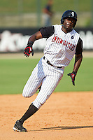 Kenny Gilbert #26 of the Kannapolis Intimidators hustles towards third base against the Hagerstown Suns at Fieldcrest Cannon Stadium on May 30, 2011 in Kannapolis, North Carolina.   Photo by Brian Westerholt / Four Seam Images