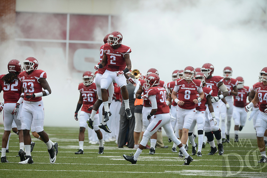 STAFF PHOTO ANTHONY REYES • @NWATONYR<br /> The Razorbacks run out onto the field before facing Nicholls State in the first quarter Saturday, Sept. 6, 2014 at Razorback Stadium in Fayetteville.