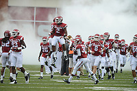 STAFF PHOTO ANTHONY REYES &bull; @NWATONYR<br /> The Razorbacks run out onto the field before facing Nicholls State in the first quarter Saturday, Sept. 6, 2014 at Razorback Stadium in Fayetteville.