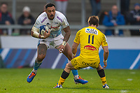 24th November 2019; AJ Bell Stadium, Salford, Lancashire, England; European Champions Cup Rugby, Sale Sharks versus La Rochelle; Denny Solomona of Sale Sharks covered by Arthur Retiere of La Rochelle - Editorial Use