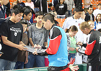 Andrew Quinn #48  and Danny Allsopp #9 of D.C. United sign autographs during an MLS match against the New England Revolution on April 3 2010, at RFK Stadium in Washington D.C.