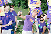 Supporters of Democratic presidential candidate and California senator Kamala Harris take a selfie before marching in the 4th of July parade in Amherst, New Hampshire, on Thu., July 4, 2019.