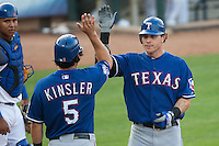 "Texas Rangers center fielder Josh Hamilton #32 is greeted by teammate Ian Kinsler #5 following his home run during the MLB exhibition baseball game against the ""AAA"" Round Rock Express on April 2, 2012 at the Dell Diamond in Round Rock, Texas. The Rangers out-slugged the Express 10-8. (Andrew Woolley / Four Seam Images)."