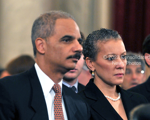 Washington, DC - January 15, 2009 -- Eric Holder, left, and his wife, Dr. Sharon Malone, right, watch as he is introduced to testify before the United States Senate Judiciary Committee confirmation hearing on his nomination as Attorney General in Washington, D.C. on Thursday, January 15, 2009..Credit: Ron Sachs / CNP.