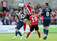 Lincoln City's Jason Shackell out-jumps Bristol Rovers' Tom Nichols<br /> <br /> Photographer Rich Linley/CameraSport<br /> <br /> The EFL Sky Bet League One - Lincoln City v Bristol Rovers - Saturday September 14th 2019 - Sincil Bank - Lincoln<br /> <br /> World Copyright © 2019 CameraSport. All rights reserved. 43 Linden Ave. Countesthorpe. Leicester. England. LE8 5PG - Tel: +44 (0) 116 277 4147 - admin@camerasport.com - www.camerasport.com