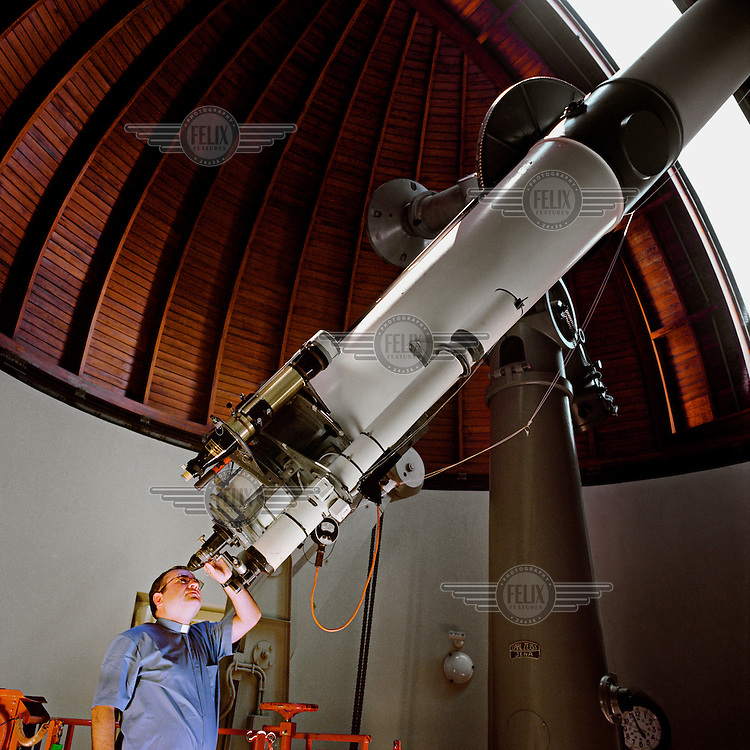 Argentinian astrologist Father Jose Funes looks through the telescope of the astronomical observatory in the Vatican....