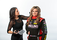Feb 6, 2019; Pomona, CA, USA; NHRA pro stock driver Erica Enders (right) poses for a portrait as sister Courtney Enders fixes her hair during NHRA Media Day at the NHRA Museum. Mandatory Credit: Mark J. Rebilas-USA TODAY Sports