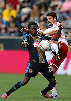 CHESTER, PA - OCTOBER 27, 2012:  Keon Daniel (26) of the Philadelphia Union battles for the ball with  Heath Pearce (3) of the New York Red Bulls during an MLS match at PPL Park in Chester, PA. on October 27. Red Bulls won 3-0.