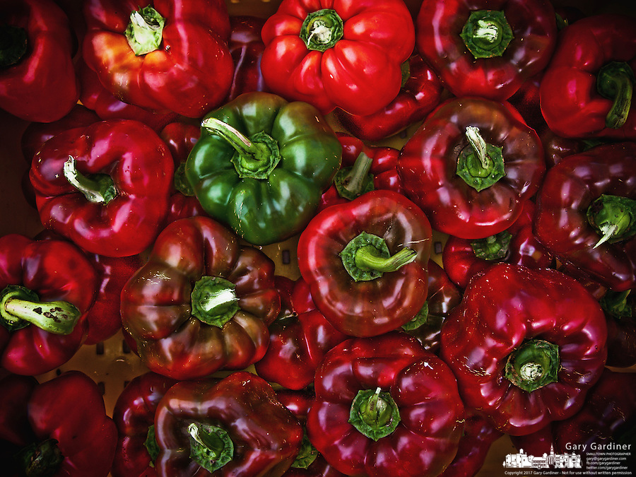 Red and green peppers for sale at farmers market