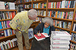 """CORAL GABLES, FL - MAY 17: Former """"Angola 3"""" inmate Albert Woodfox sign copies of his book to author Les Standiford """"Solitary"""" at Books & Books on May 17, 2019 in Coral Gables, Florida. ( Photo by Johnny Louis / jlnphotography.com )"""