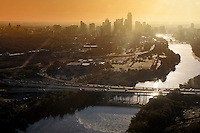 High angle aerial view of the downtown Austin skyline, Mopac Expressway during morning sunrise from a helicopter in downtown Austin, Texas.