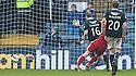 Dundee's David Clarkson scores their second goal .